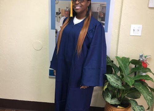 a graduate pose
