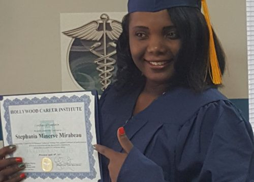 a graduate holding her certificate